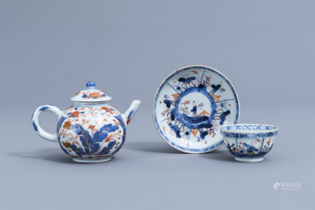 A Chinese Imari style teapot and cover with floral design and a cup and saucer with boys, Kangxi/Qianlong