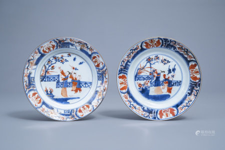 A pair of Chinese Imari style plates with figures in a garden, Kangxi