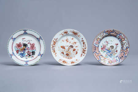 Three Chinese famille rose and iron red 'rooster' plates, Yongzheng/Qianlong