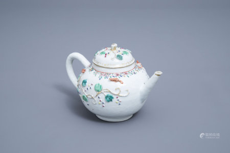 A Chinese famille rose teapot and cover with floral relief design and squirrels, Yongzheng