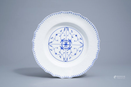 A large blue and white Tournai porcelain lobed charger with floral design, 19th C.