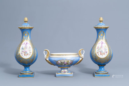 A pair of French gold layered 'bleu celeste' ground vases and covers in the Sèvres manner and an Empire style centrepiece, 19th/20th C.