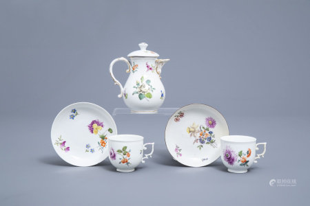 A German Meissen porcelain jug and cover and two cups and saucers with floral design, 19th/20th C.