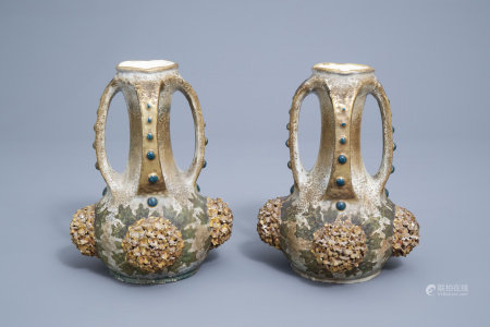 A pair of polychrome, gilt and iridescent Amphora Austria Art Nouveau relief decorated ceramic vases, first quarter of the 20th C.