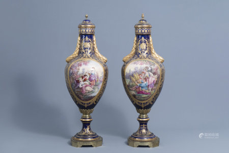 A pair of large French Sèvres styles vases and covers with gallant scenes and landscapes, 20th C.