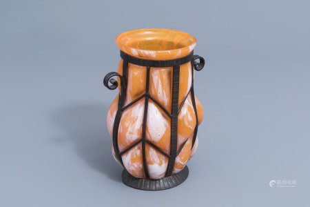 A French glass and wrought iron Art Deco vase, probably Verreries d'Art Lorrain, 20th C.