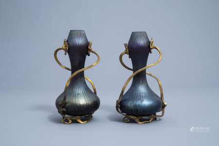 A pair of iridescent Art Nouveau style gilt floral mounted double gourd vases in the manner of Johann Loetz, 20th C.