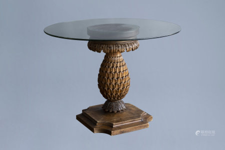 A wooden 'pineapple' table with round glass top, ca. 1900