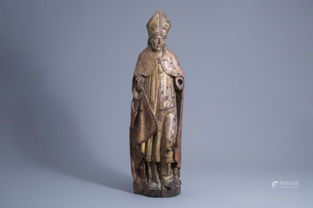 A carved, polychrome painted and gilt wooden figure of a bishop, Southern Netherlands, Flanders, 16th C.