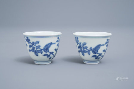 A pair of Chinese blue and white cups with birds among blossoming branches, Chenghua mark, 19th/20th C.
