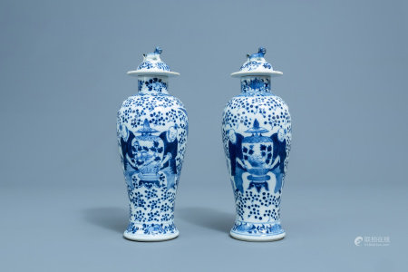 A pair of Chinese blue and white vases and covers with boys and antiquities, Qianlong mark, 19th C.