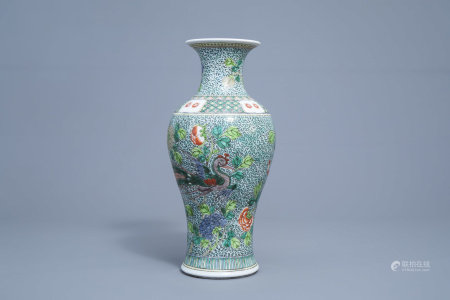 A Chinese famille verte baluster vase with phoenixes among blossoming branches, 19th/20th C.