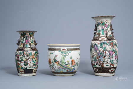 Two Chinese Nanking crackle glazed famille rose vases with warrior scenes and a jardiniere with birds among blossoming brances, 19th/20th C.