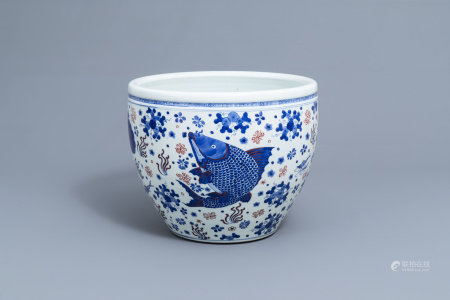 A Chinese blue, white and copper red fish bowl with fish, 19th/20th C.