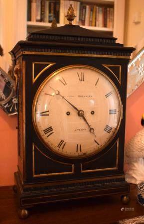 A GEORGE III EBONISED MAHOGANY BRACKET CLOCK by Molyneux of London, lion mask head handles and circular dial. 50 cm x 23 cm.