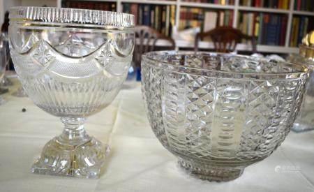 A REGENCY PEDESTAL CUT CRYSTAL GLASS PEDESTAL BOWL together with another similar large diamond cut crystal bowl. Largest 24 cm x 18 cm. (2)