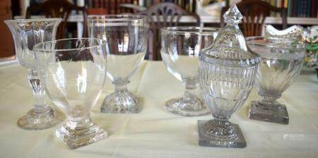A REGENCY GUT GLASS VASE AND COVER possibly Irish, together with other antique glass pedestal bowls. Largest 17 cm x 12 cm. (6)