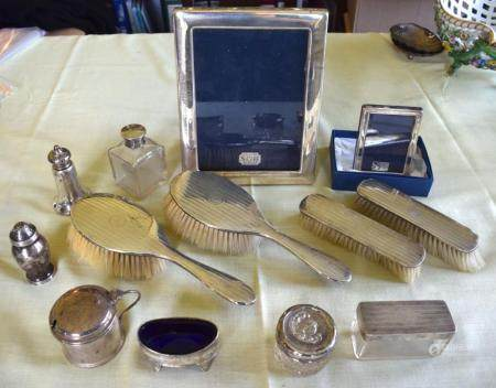 AN ART DECO SILVER DRESSING TABLE SET together with two silver frames, silver topped bottles & jars etc. Weighable silver 225 grams. (qty)