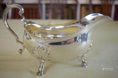 A GEORGE III STYLE SILVER SAUCE BOAT Retailed by Tessiers of London. London 1963. 355 grams. 22 cm x 10 cm.