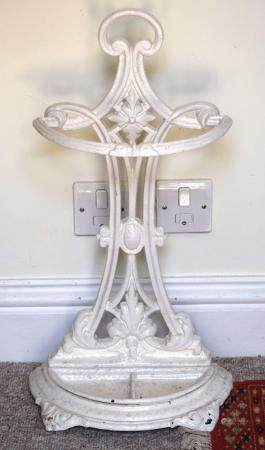 AN ARTS AND CRAFTS CAST IRON UMBRELLA STAND in the manner of Dresser. 66 cm x 27 cm.