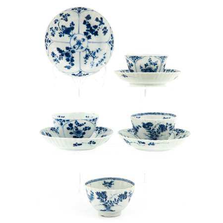 A Set of 4 Blue and White Cups and Saucers