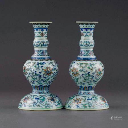 Qing Dynasty PAIR QIANLONG DOUCAI SCROLLING FLORAL CANDLE STANDS
