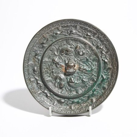 唐 海兽葡萄纹铜镜 A Silvery Bronze 'Lion And Grapevine' Mirror, Tang Dynasty (AD 618-907)