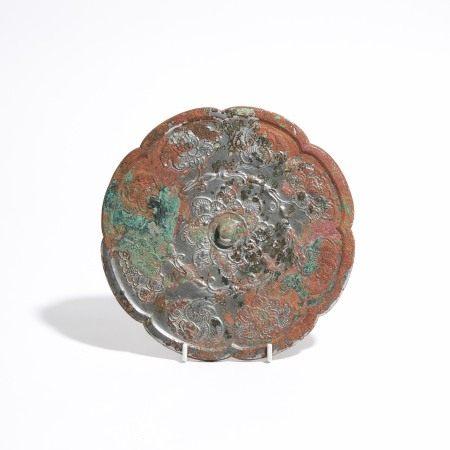 唐 青铜折枝花卉纹镜 A Bronze Octalobed 'Flower' Mirror, Tang Dynasty (AD 618-907)