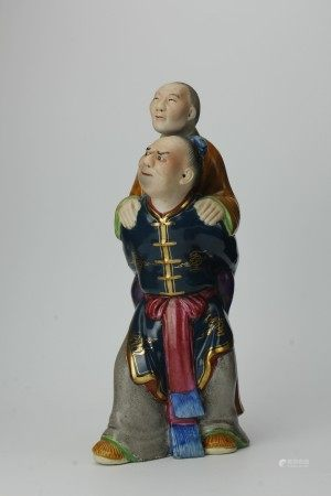 A Chinese Ceramic Figurine of Son Carrying Mother Filial Piety