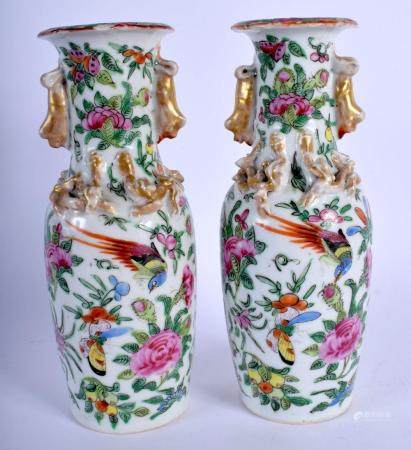 A PAIR OF LATE 19TH CENTURY CHINESE FAMILLE ROSE CANTON PORCELAIN VASES painted with birds and flowers. 20.5 cm high.