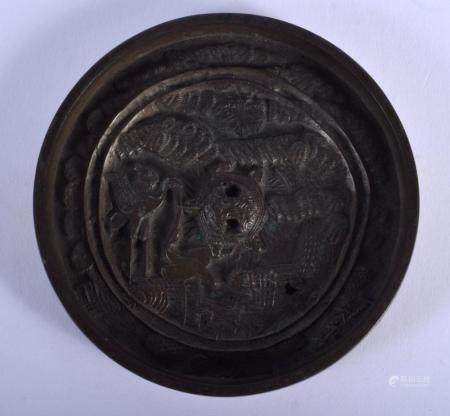 AN 18TH CENTURY JAPANESE EDO PERIOD BRONZE HAND MIRROR decorated with mythical beasts and landscapes. 11.5 cm diameter.