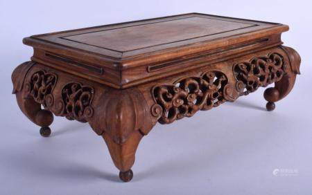A 19TH CENTURY CHINESE CARVED HARDWOOD RECTANGULAR STAND Qing, possibly Huanghuali, decorated with lingzhi fungus and vines. 46 cm x 30 cm x 18 cm.