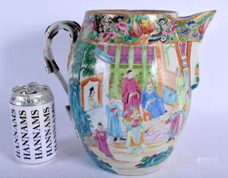 A LARGE 19TH CENTURY CHINESE CANTON FAMILLE ROSE PORCELAIN CIDER JUG Qing, painted with figures within landscapes. 25 cm x 18 cm.