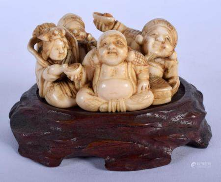 A 19TH CENTURY JAPANESE MEIJI PERIOD CARVED IVORY FIGURE OF BUDDHAS modelled in various pursuits. Ivory 6.5 cm x 4.5 cm.