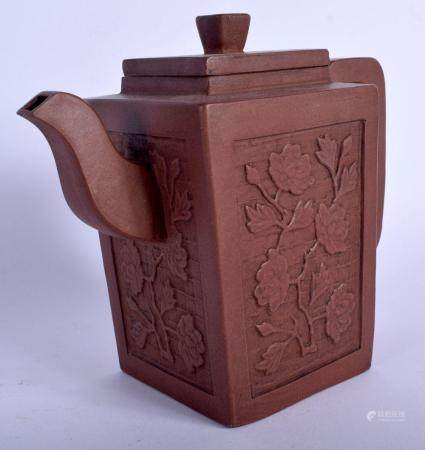 AN EARLY 20TH CENTURY CHINESE YIXING POTTERY TEAPOT AND COVER decorated with flowers and vines. 15 cm x 15 cm.