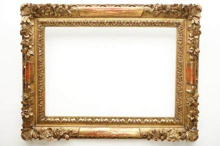A sculpted gilt wood frame, 19th C.