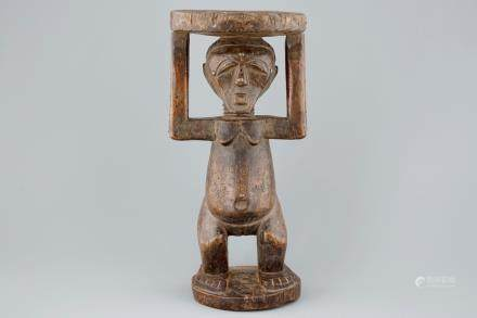 An African carved wood stool, Songye, Congo, 1st half 20th C.