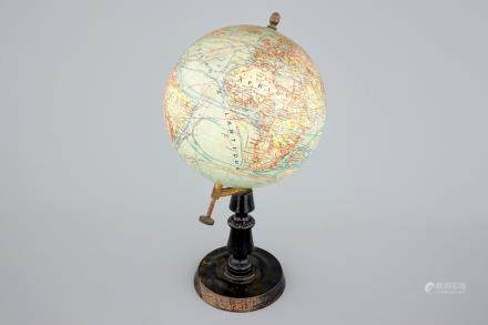 A globe on wood stand, edited by Forest in Paris, ca. 1925