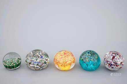 A set of five glass paperweights, 20th C.