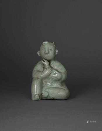 SUJET en céramique émaillée céladon, représentant un enfant assis tenant une oie dans ses bras. (Défauts de cuisson). Chine,...