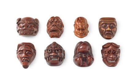 A group of eight wood mask netsuke Edo period (1615-1868) to Showa era (1926-1989), 19th/20th century