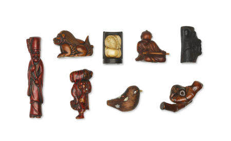 A group of eight wood and stag-antler netsuke Edo period (1615-1868) or Meiji era (1868-1912), late 19th/early 20th century