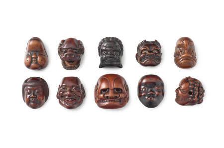 A group of ten wood mask netsuke Edo period (1615-1868) or Meiji era (1868-1912), late 19th/early 20th century