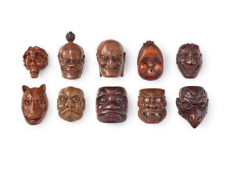 A group of ten wood mask netsuke  Edo period (1615-1868) to Showa era (1926-1989), 19th/20th century