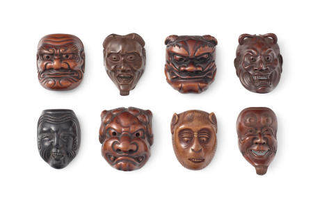 A group of eight wood mask netsuke Edo period (1615-1868) or Meiji era (1868-1912), 19th/20th century
