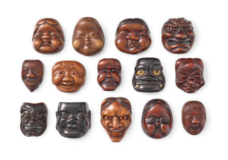 A group of 14 wood and lacquered wood mask netsuke Edo period (1615-1868) or Meiji era (1868-1912), 19th/20th century