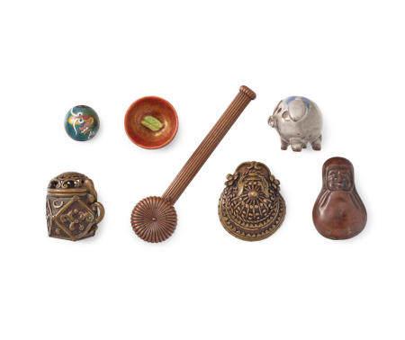 A group of three metal netsuke, two ceramic netsuke, a yatate and an ojime Edo period (1615-1868) to Showa era (1926-1989), 19th/20th century