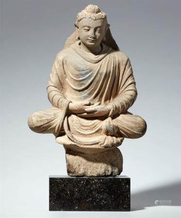 A Gandhara grey schist figure of Buddha Shakyamuni. Pakistan. 2nd/3rd century