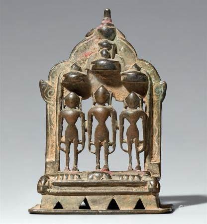 A small copper alloy Jain altar of three tirthankara. Western India, Gujarat. Dated by inscription 1478