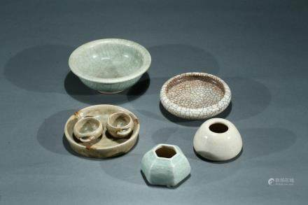 A set of five glazed ceramic objects
